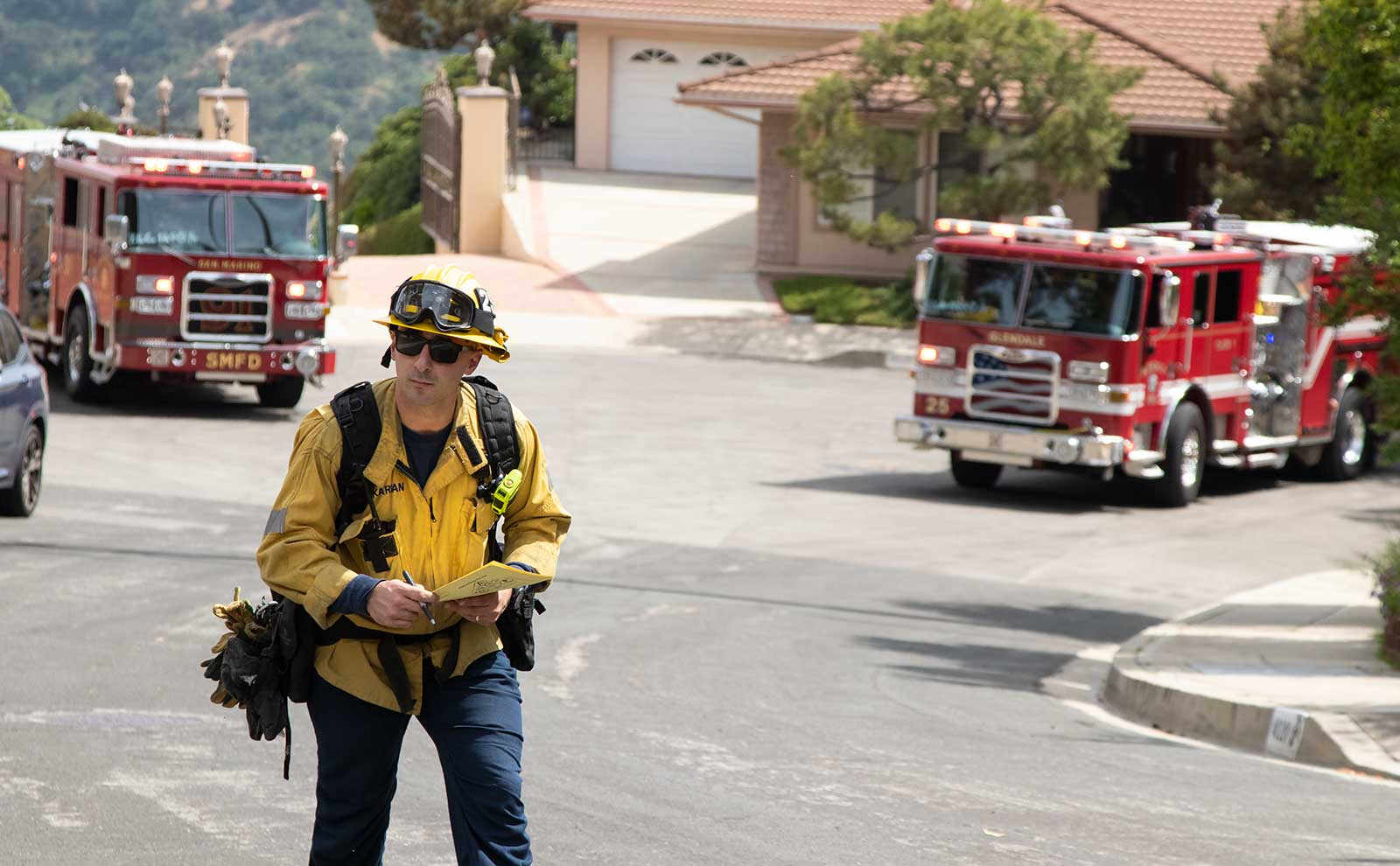 Firefighters canvas neighborhood in wildfire drill.